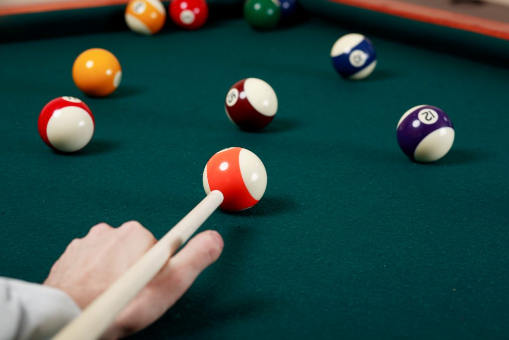 Pool player enjoys game on new billiard table